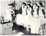 Student nurses learning how to wash hair.