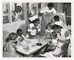 Student nurses and children in play room, 1952.