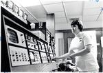 Registered nurse at central monitor recording EKGs
