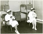 Registered nurse and student nurse feeding babies